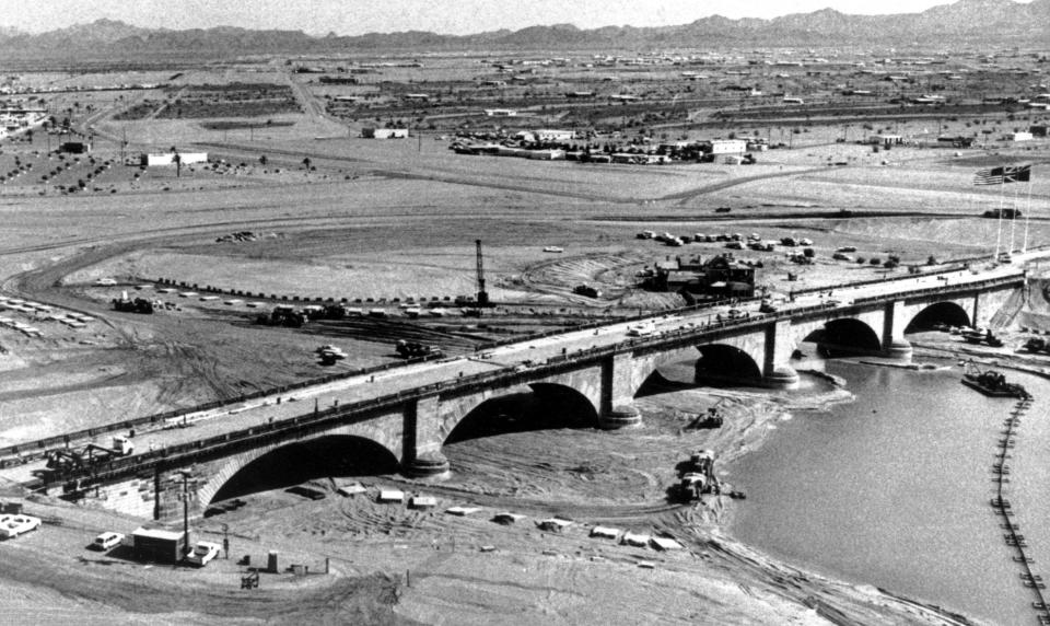 FILE - In this Sept. 8, 1971 file photo the historic London Bridge straddles a moat of water during its reconstruction in Lake Havasu City, Ariz. The 140-year-old span was bought at a public auction more than three years ago. Lake Havasu City is playing up its roots with a month of celebratory events marking the 50th anniversary of the dedication of the London Bridge after its piece-by-piece rebuild in the resort town along the Colorado River. Scheduled October events include a parade, powerboat racing, theater and musical performances, sports competitions and a garden brunch and tea.(AP Photo, File)