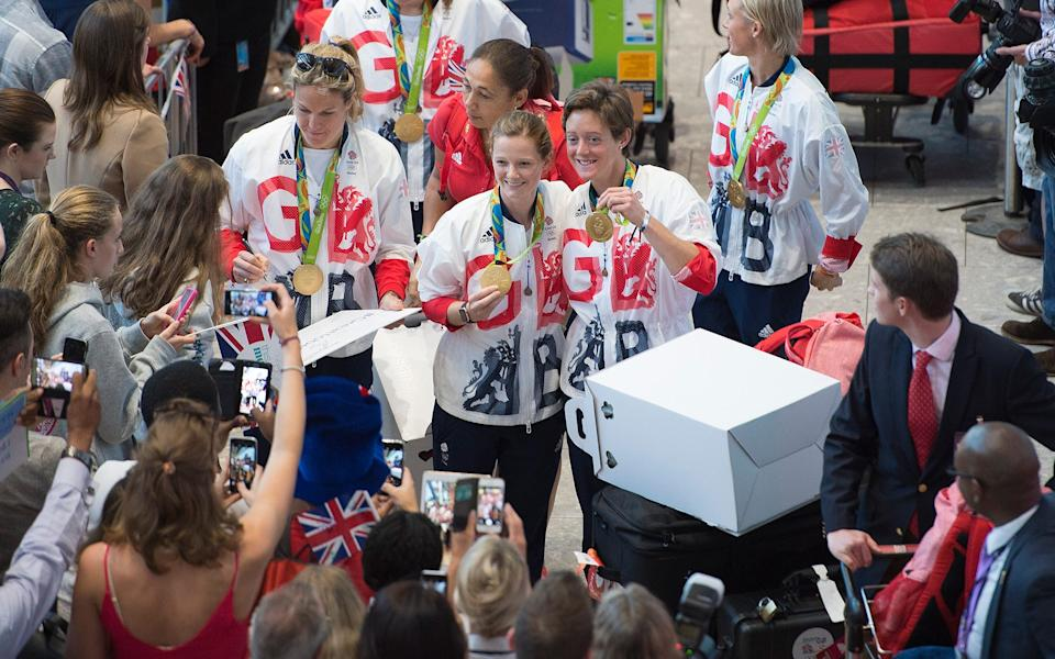 Team GB athletes are welcomed home at Heathrow - EDDIE MULHOLLAND