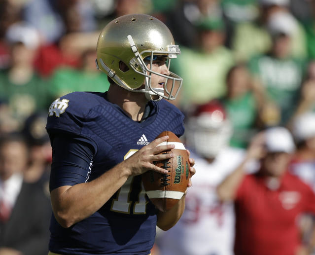 Notre Dame's Tommy Rees (11) looks to throw during the first half of an NCAA college football game against Oklahoma on Saturday, Sept. 28, 2013, in South Bend, Ind. (AP Photo/Darron Cummings)