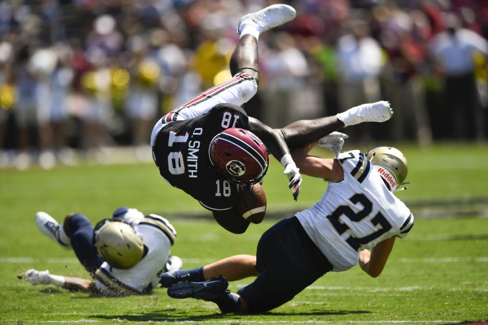 South Carolina wide receiver OrTre Smith (18) is upended by Charleston Southern linebacker Jake Lanford (27) during the first half of an NCAA college football game Saturday, Sept. 7, 2019, in Columbia, S.C. (AP Photo/John Amis)