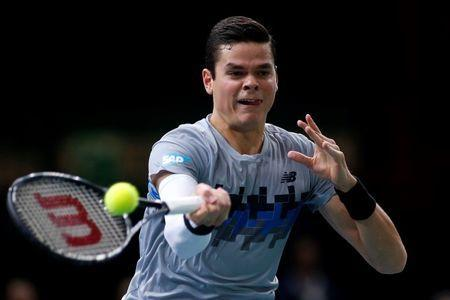 Milos Raonic of Canada returns a shot against Switzerland's Roger Federer during their quarter-final match at the Paris Masters tennis tournament at the Bercy sports hall in Paris, October 31, 2014. REUTERS/Benoit Tessier