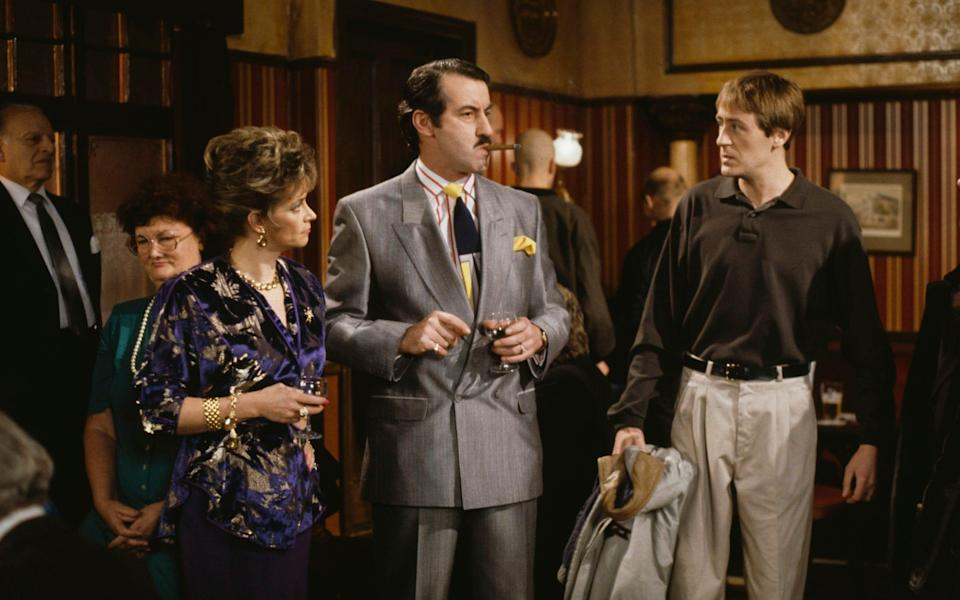 Challis, centre, at the Nag's Head with his wife Marlene (Sue Holderness) and Del Boy's younger brother Rodney Trotter (Nicholas Lyndhurst): an episode of Only Fools and Horses from 1991 - Don Smith/Radio Times/Getty Images
