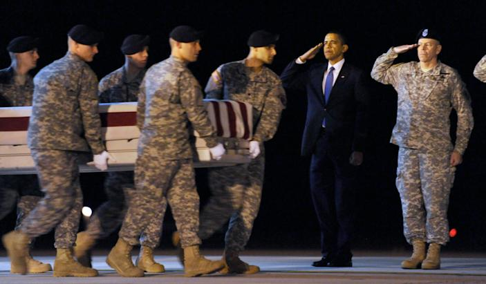 President Barack Obama salutes as a transfer case containing the remains of Army Sgt. Dale R. Griffin, 29, of Terre Haute, Indiana, who died in Afghanistan, arrives at Dover Air Force Base in Delaware on Oct. 29, 2009.