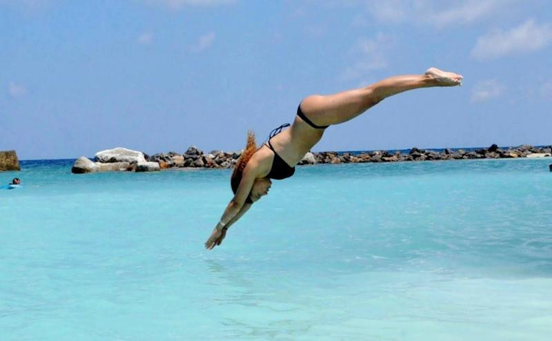 A woman diving into the sea.