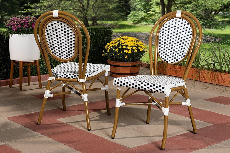 """<p><strong>Baxton Studio</strong></p><p>totallyfurniture.com</p><p><strong>$150.49</strong></p><p><a href=""""https://go.redirectingat.com?id=74968X1596630&url=https%3A%2F%2Fwww.totallyfurniture.com%2Fbaxton-studio-gauthier-classic-french-indoor-and-outdoor-navy-and-white-bamboo-style-bistro-stackable-dining-chair-set-of-2-95-wa-4094-navy-white-dc&sref=https%3A%2F%2Fwww.goodhousekeeping.com%2Fhome-products%2Fg32743125%2Fbest-patio-chairs%2F"""" rel=""""nofollow noopener"""" target=""""_blank"""" data-ylk=""""slk:Shop Now"""" class=""""link rapid-noclick-resp"""">Shop Now</a></p><p>A visit to a Paris cafe might not be on your calendar, but this cute stacking chair can give your patio the French flair you love so much.</p>"""