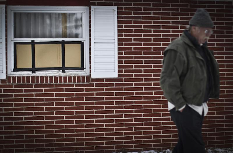 In a Sunday, Nov. 25, 2012 photo, Byron David Smith's brother walks past the bedroom window of Byron's home where Nick Brady, and cousin Haile Kifer, allegedly broke in before they were shot and killed by Byron on Thanksgiving Day, in Little Falls, Minn. Byron David Smith, 64, of Little Falls, told police he shot Kifer, 18, and Brady, 17, during a break-in Thursday. But authorities said his actions exceeded reasonable self-defense and planned to charge him Monday with second-degree murder. (AP Photo/The Star Tribune, Renee Jones Schneider) MANDATORY CREDIT; ST. PAUL PIONEER PRESS OUT; MAGS OUT; TWIN CITIES TV OUT
