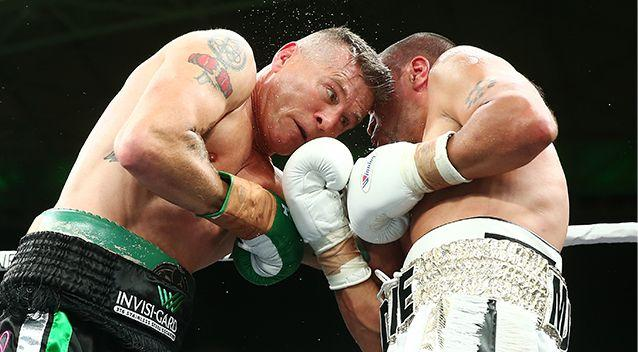 Mundine slips an uppercut during his cruiserweight rematch with Danny Green at the Adelaide Oval on Friday. Photo: Getty Images