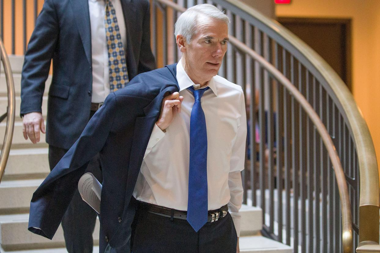 Sen. Rob Portman, R-Ohio, arrives for a closed-door briefing for the members of the Senate Foreign Relations Committee, Tuesday, March 5, 2019, in Washington. (AP Photo/Alex Brandon)