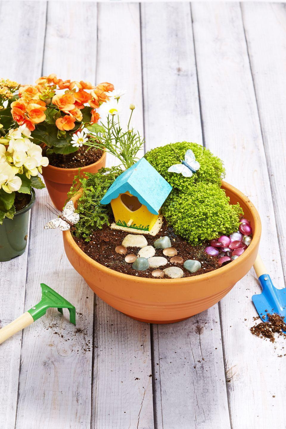 """<p>Think small — really small — with this adorable project. Outfitted with a mini birdhouse, rustic stones, and teeny-tiny accessories, this planter is the perfect thing to make with kids. </p><p><em><a href=""""https://www.goodhousekeeping.com/home/craft-ideas/a33567/fairy-garden-how-to/"""" rel=""""nofollow noopener"""" target=""""_blank"""" data-ylk=""""slk:Get the tutorial »"""" class=""""link rapid-noclick-resp"""">Get the tutorial »</a></em></p>"""