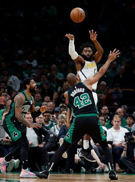 PHOTO: Indiana Pacers' Tyreke Evans throws a pass over Boston Celtics' Al Horford during the second quarter in Game 1 of a first-round NBA basketball playoff series, Sunday, April 14, 2019, in Boston. (AP Photo/Winslow Townson)