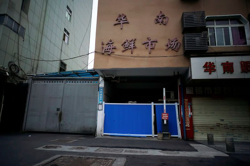 FILE PHOTO: A blocked entrance to Huanan seafood market is seen in Wuhan