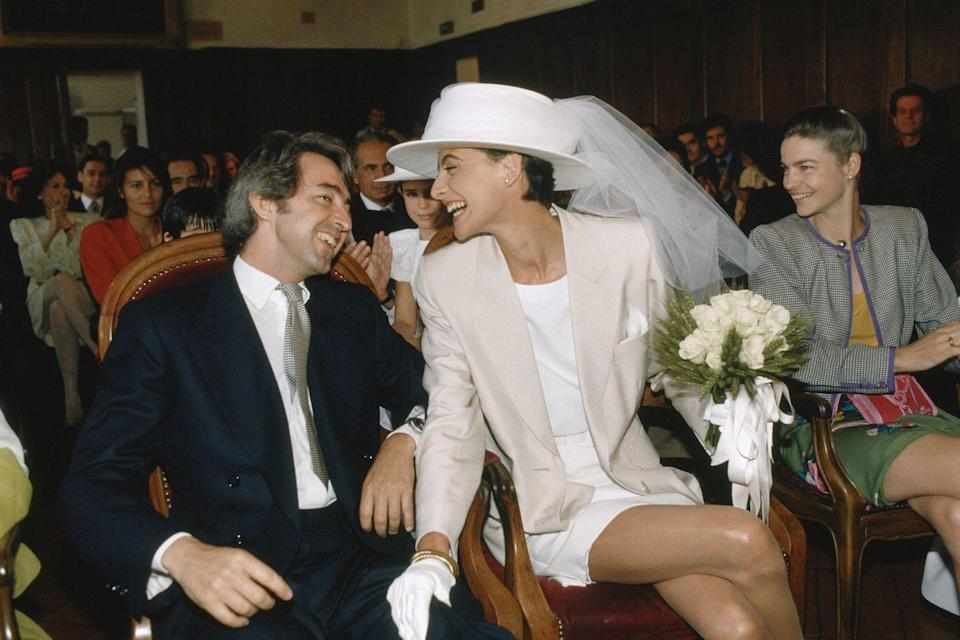 <p>The always-chic Ines de la Fressange opted for an unconventional mini, accessorized with white gloves and dramatic veil.</p>
