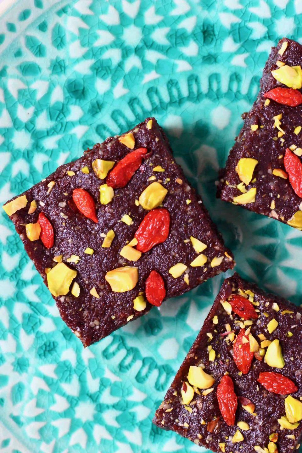 """<p>Vegans, whip up a batch of these five-ingredient brownies and stash 'em in the fridge for when cravings strike. </p><p><a class=""""link rapid-noclick-resp"""" href=""""https://www.rhiansrecipes.com/no-bake-brownies/"""" rel=""""nofollow noopener"""" target=""""_blank"""" data-ylk=""""slk:GET THE RECIPE"""">GET THE RECIPE</a></p><p><em>Per serving: 248 calories, 18 g fat (2 g sat), 22 g carbs, 2 mg sodium, 15 g sugar, 4 g fiber, 5 g protein</em></p>"""