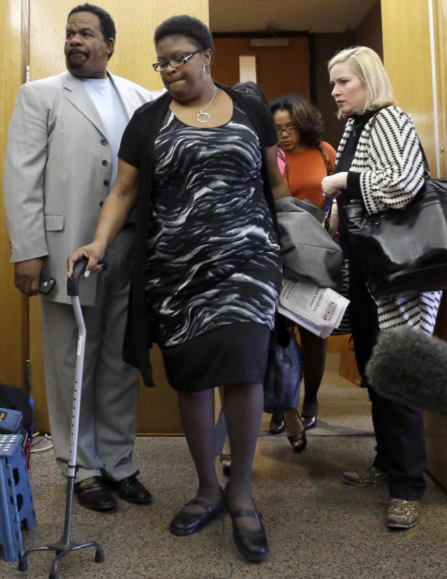 LaTasha Brent, center, the mother of former Dallas Cowboys NFL football player Josh Brent, walks from court with attorney Deandra Grant, right, and David Wells after Brent was found guilty of intoxication manslaughter Wednesday, Jan. 22, 2014, in Dallas, for a fiery wreck that killed his teammate and close friend, Jerry Brown. Brent faces up to 20 years in prison for the December 2012 wreck after a night of partying with fellow Cowboys players. He could also get probation. (AP Photo/LM Otero)