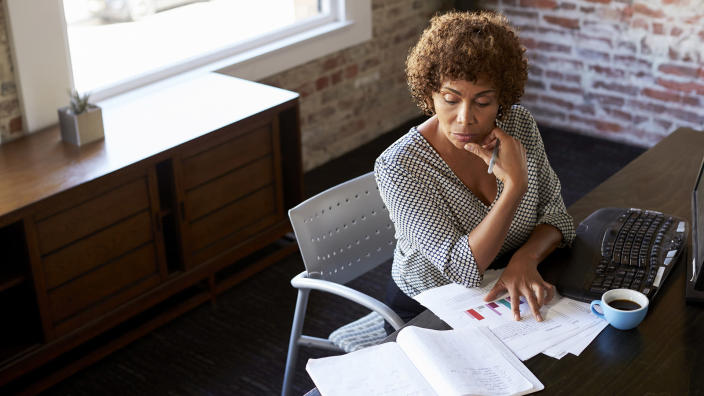 Mature Businesswoman Working In Office.