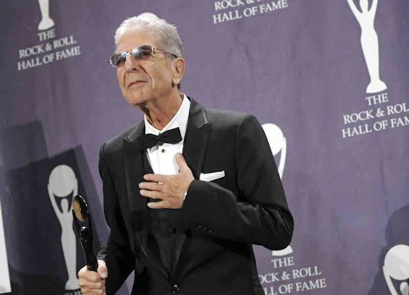 """CORRECTS DATE OF STATEMENT- FILE - In this March 10. 2008, file photo, musician Leonard Cohen poses backstage at the Rock and Roll Hall of Fame Induction Ceremony after he was inducted in New York. Cohen, the gravelly-voiced Canadian singer-songwriter of hits like """"Hallelujah,"""" """"Suzanne"""" and """"Bird on a Wire,"""" has died, his management said in a statement Thursday, Nov. 10, 2016. He was 82. (AP Photo/Evan Agostini, File)"""