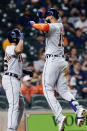 Detroit Tigers' Jeimer Candelario, left, and Nomar Mazara (15) celebrate at the plate after they scored Mazara's home run against the Houston Astros during the fourth inning of a baseball game Tuesday, April 13, 2021, in Houston. (AP Photo/Michael Wyke)