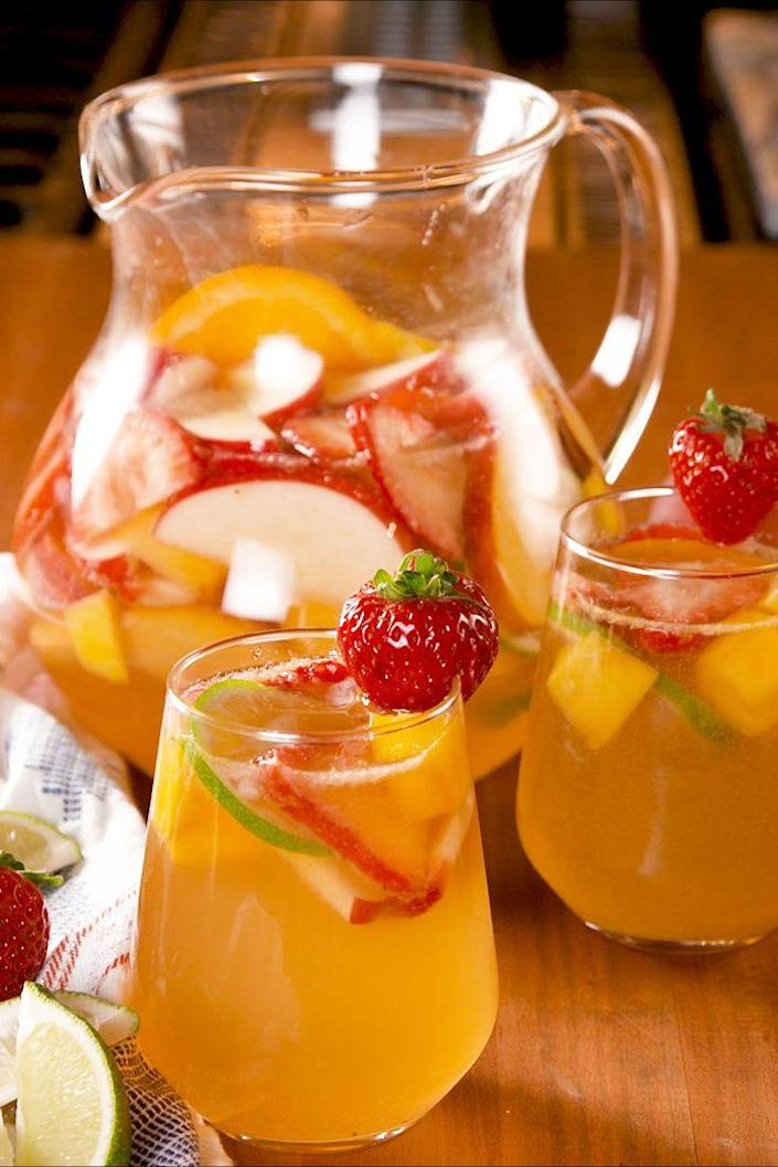 """<p>A little seltzer makes this sangria even better for daytime.</p><p>Get the recipe from <a href=""""https://www.delish.com/cooking/recipe-ideas/a27103875/white-wine-sangria-recipe/"""" rel=""""nofollow noopener"""" target=""""_blank"""" data-ylk=""""slk:Delish"""" class=""""link rapid-noclick-resp"""">Delish</a>.</p>"""