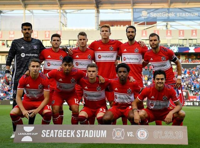 The Chicago Fire starting 11 pose before a game agaisnt Cruz Azul in July 2019 (AFP Photo/Quinn Harris)