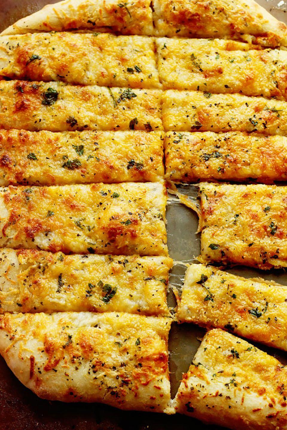 "<p>These breadsticks will put your favorite pizza place to shame. Serve them with warm pizza sauce for added flavor.</p><p><strong>Get the recipe at <a href=""http://www.grandbaby-cakes.com/2015/01/cheese-breadsticks/"" rel=""nofollow noopener"" target=""_blank"" data-ylk=""slk:Grandbaby Cakes"" class=""link rapid-noclick-resp"">Grandbaby Cakes</a>.</strong></p>"
