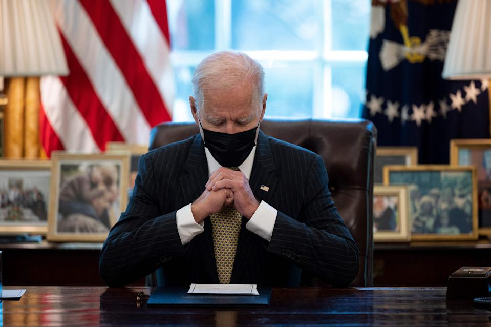 US president Joe Biden prepares to sign the Paycheck Protection Program (PPP) Extension Act of 2021 into law at the White House in Washington, DC, on 30 March. Photo: Jim Watson/AFP via Getty Images