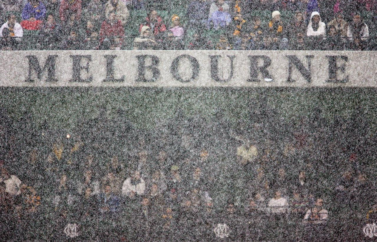 MELBOURNE, AUSTRALIA - APRIL 30: A general view of rain falling in front of the Melbourne Cricket Club Members Stand during the round five AFL match between the Hawthorn Hawks and the Essendon Bombers at the Melbourne Cricket Ground April 30, 2006 in Melbourne, Australia. (Photo by Ryan Pierse/Getty Images)