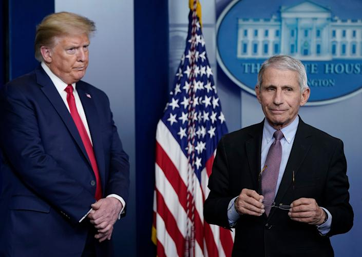 Dr Fauci (R), director of the National Institute of Allergy and Infectious Diseases, and President Trump participate in the daily coronavirus task force briefing at the White House (Getty Images)