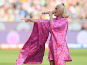 The singer did a couple of outfit changes during her ICC Women's T20 Cricket World Cup Final performance. This bright mini dress - complete with bat sleeves and a high neck - was taken off to reveal an empowering purple mini dress. (Getty Images)
