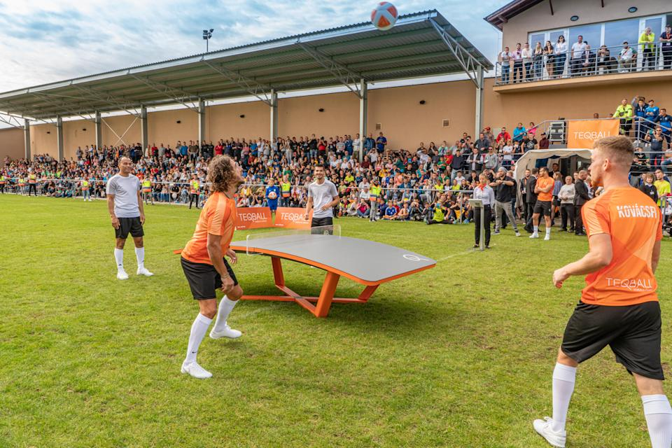 Carles Puyol and Cafu playing a game of teqball (Teqball)
