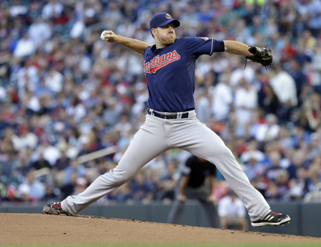 Cleveland Indians pitcher Zach McAllister throws against the Minnesota Twins in the first inning of a baseball game, Tuesday, Aug. 13, 2013 in Minneapolis. (AP Photo/Jim Mone)