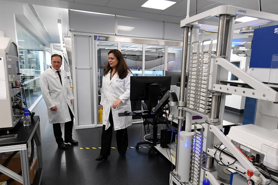 Pictured is Federal Health Minister Greg Hunt (left) tours the National Drug Discovery Centre at the Walter and Eliza Hall Institute of Medical Research in Melbourne, Tuesday, June 2, 2020.