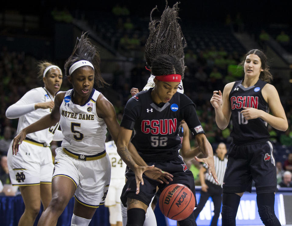 Notre Dame's Jackie Young (5) competes for the ball with Cal State Northridge's ElizaMatthews (52) during a first-round game in the NCAA women's college basketball tournament Friday, March 16, 2018, in South Bend, Ind. (AP Photo/Robert Franklin)