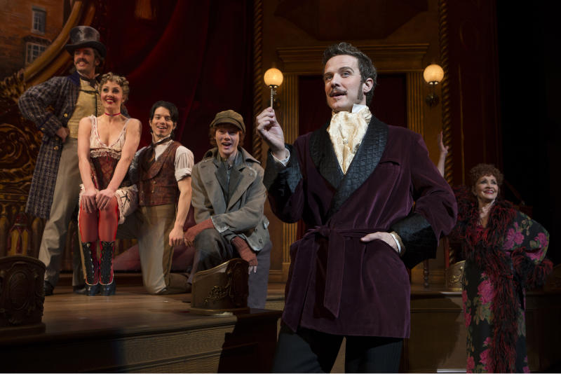 """This theater image released by Boneau-Bryan/Brown shows, from left, Eric Sciotto, Shannon Lewis, kyle Coffman, Nicholas Barasch, Will Chase and Chita Rivera in a scene from """"The Mystery of Edwin Drood,"""" playing at the Roundabout Theatre Company at Studio 54 in New York. (AP Photo/Boneau-Bryan/Brown, Joan Marcus)"""