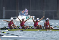 Chen Yunxia, Zhang Ling, Lyu Yang and Cui Xiaotong of China celebrate after winning gold in the women's rowing quadruple sculls final at the 2020 Summer Olympics, Wednesday, July 28, 2021, in Tokyo, Japan. (AP Photo/Darron Cummings)