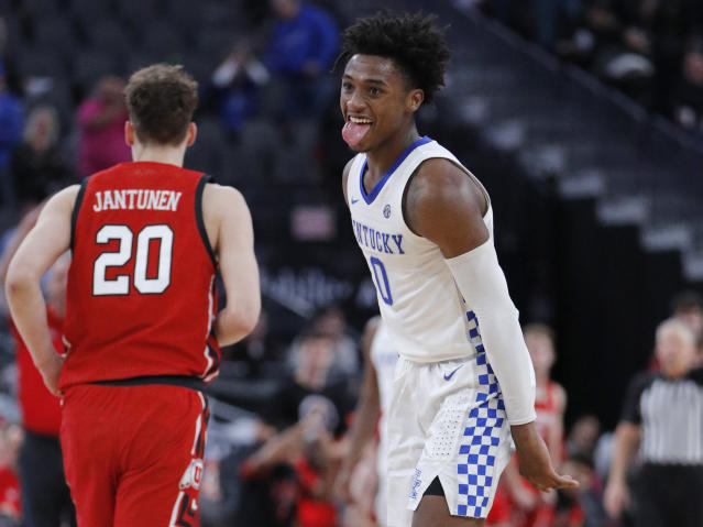 Kentucky's Ashton Hagans (0) reacts after a play during the second half of the team's NCAA college basketball game against Utah on Wednesday, Dec. 18, 2019, in Las Vegas. (AP Photo/John Locher)