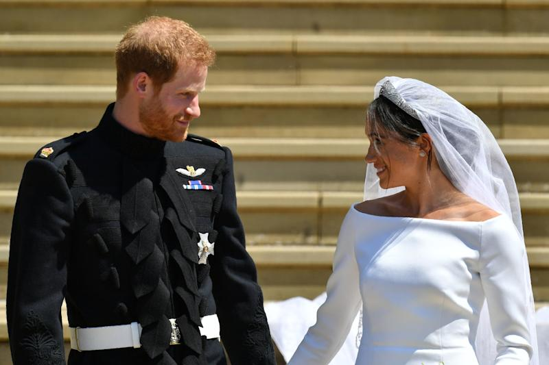 TOPSHOT - Britain's Prince Harry, Duke of Sussex and his wife Meghan, Duchess of Sussex leave from the West Door of St George's Chapel, Windsor Castle, in Windsor, on May 19, 2018 after their wedding ceremony. (Photo by Ben Birchall / POOL / AFP) (Photo credit should read BEN BIRCHALL/AFP/Getty Images)