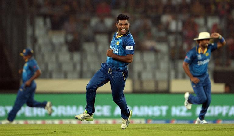 Sri Lanka bowler Seekkuge Prasanna (centre) celebrates after taking the wicket of West Indies batsman Lendl Simmons in the World Twenty20 first semi-final at The Sher-e-Bangla National Cricket Stadium in Dhaka on April 3, 2014