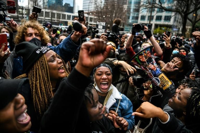 People celebrate as the verdict is announced in the trial of former police officer Derek Chauvin outside the Hennepin County Government Center in Minneapolis
