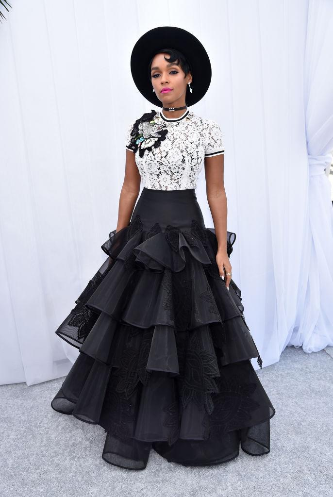 <p>The stylish star worked the lace trend with her white top and a voluminous black skirt. (Photo: Getty Images) </p>