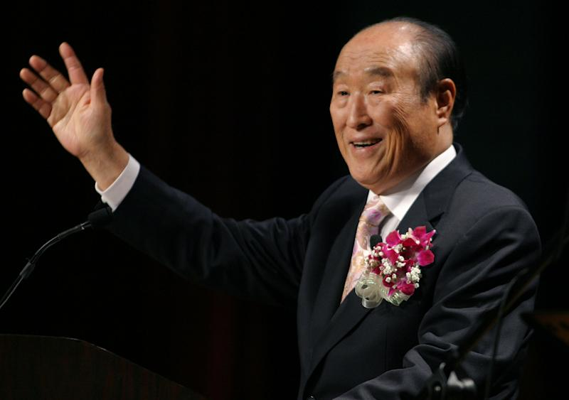 """FILE - In this Saturday, June 25, 2005 file photo, Unification Church leader Rev. Sun Myung Moon speaks during his """"Now is God's Time"""" rally in New York. Moon, self-proclaimed messiah who founded the Unification Church, has died at age 92 church officials said Monday, Sept. 3, 2012. (AP Photo/John Marshall Mantel)"""
