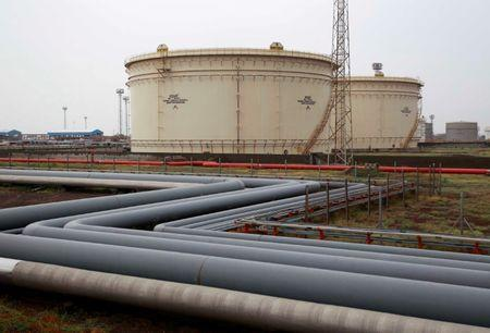 Storage tanks of an oil refinery of Essar Oil are pictured in Vadinar
