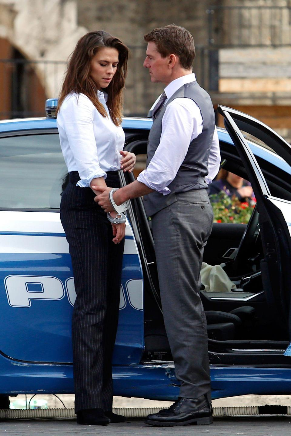 <p>Tom Cruise and Hayley Atwell are seen handcuffed together while filming <em>Mission Impossible 7</em> at Imperial Fora in Rome, Italy on Tuesday.</p>