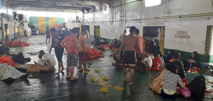 In this photo provided by Philippine Coast Guard in Manila, rescued passengers of the ill-fated M/V Lite Ferry 16, are attended to by the coast guard rescuers and crew of responding vessels, on a ferry which responded to the incident, following an overnight ferry fire Wednesday, Aug. 28, 2019, off Dapitan city in Zamboanga del Norte province in southern Philippines. (Philippine Coast Guard via AP)