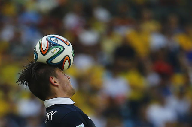 France's Mathieu Debuchy heads the ball during their 2014 World Cup quarter-finals against Germany at the Maracana stadium in Rio de Janeiro July 4, 2014. REUTERS/Kai Pfaffenbach (BRAZIL - Tags: SOCCER SPORT WORLD CUP TPX IMAGES OF THE DAY)
