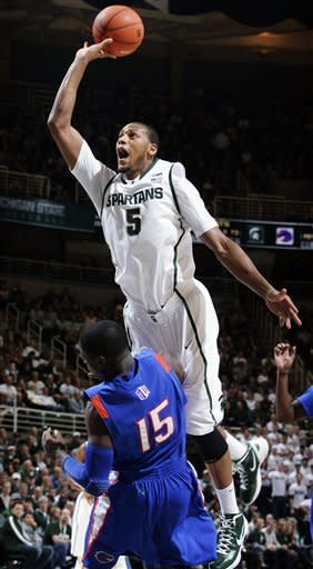 Michigan State's Adreian Payne (5) collides with Boise State's Thomas Bropleh (15) while driving to the basket during the first half of an NCAA college basketball game, Tuesday, Nov. 20, 2012, in East Lansing, Mich. Payne was called for an offensive foul. (AP Photo/Al Goldis)