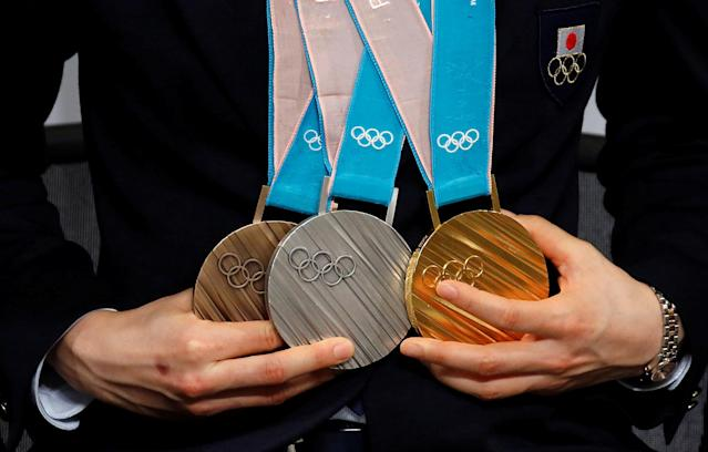 Pyeongchang 2018 Winter Olympics Women's speed skating medallist Miho Takagi poses with her gold, silver and bronze medals at a news conference with other medalists upon their return from the Pyeongchang Winter Games, in Tokyo Japan, February 26, 2018. REUTERS/Toru Hanai