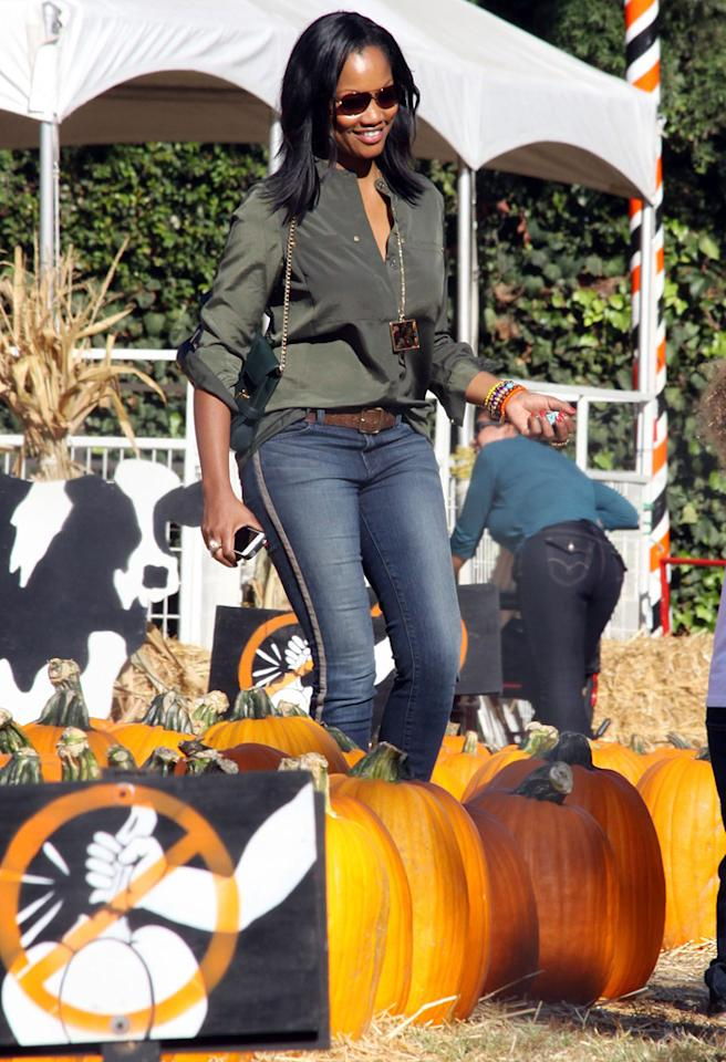 "That's Garcelle Beauvais behind those shades! The ""Franklin & Bash"" actress almost always shows up for family-themed events with her young twin sons. (10/8/2012)"