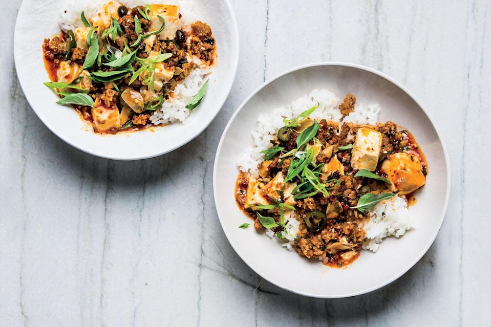 """Spicy, mouth-tingling, porky: Those are the words you'll be using to describe this tofu recipe. <a href=""""https://www.epicurious.com/recipes/food/views/weeknight-mapo-tofu-with-ground-pork?mbid=synd_yahoo_rss"""" rel=""""nofollow noopener"""" target=""""_blank"""" data-ylk=""""slk:See recipe."""" class=""""link rapid-noclick-resp"""">See recipe.</a>"""