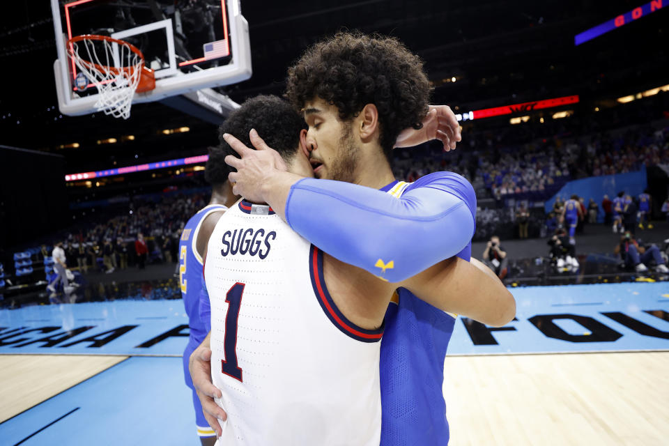 INDIANAPOLIS, INDIANA - APRIL 03: Jalen Suggs #1 of the Gonzaga Bulldogs hugs Johnny Juzang #3 of the UCLA Bruins after the Gonzaga Bulldogs defeated the UCLA Bruins 93-90 in overtime during the 2021 NCAA Final Four semifinal at Lucas Oil Stadium on April 03, 2021 in Indianapolis, Indiana. (Photo by Jamie Squire/Getty Images)