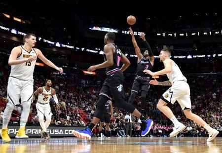 Jan 8, 2019; Miami, FL, USA; Miami Heat guard Dwyane Wade (3) shoots over Denver Nuggets center Nikola Jokic (15) during the second half at American Airlines Arena. Mandatory Credit: Steve Mitchell-USA TODAY Sports
